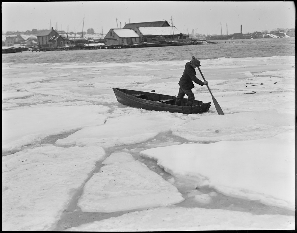 Boat and man in ice water Boston